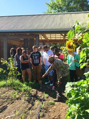 Farmer Dishaun introduces freshman to the farm.