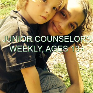 "A young camper and junior counselor look at the camera. The words ""Junior Counselors, Weekly, Ages 13+"" are written across the photo."