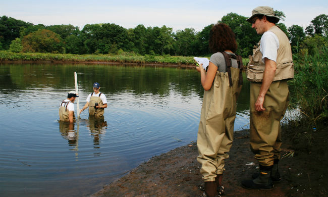 Common Ground High School students study water quality in the river that flows near their campus as a part of Green Jobs Corps, an environmental employment and leadership training program.