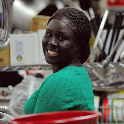 Fatou working in the kitchen
