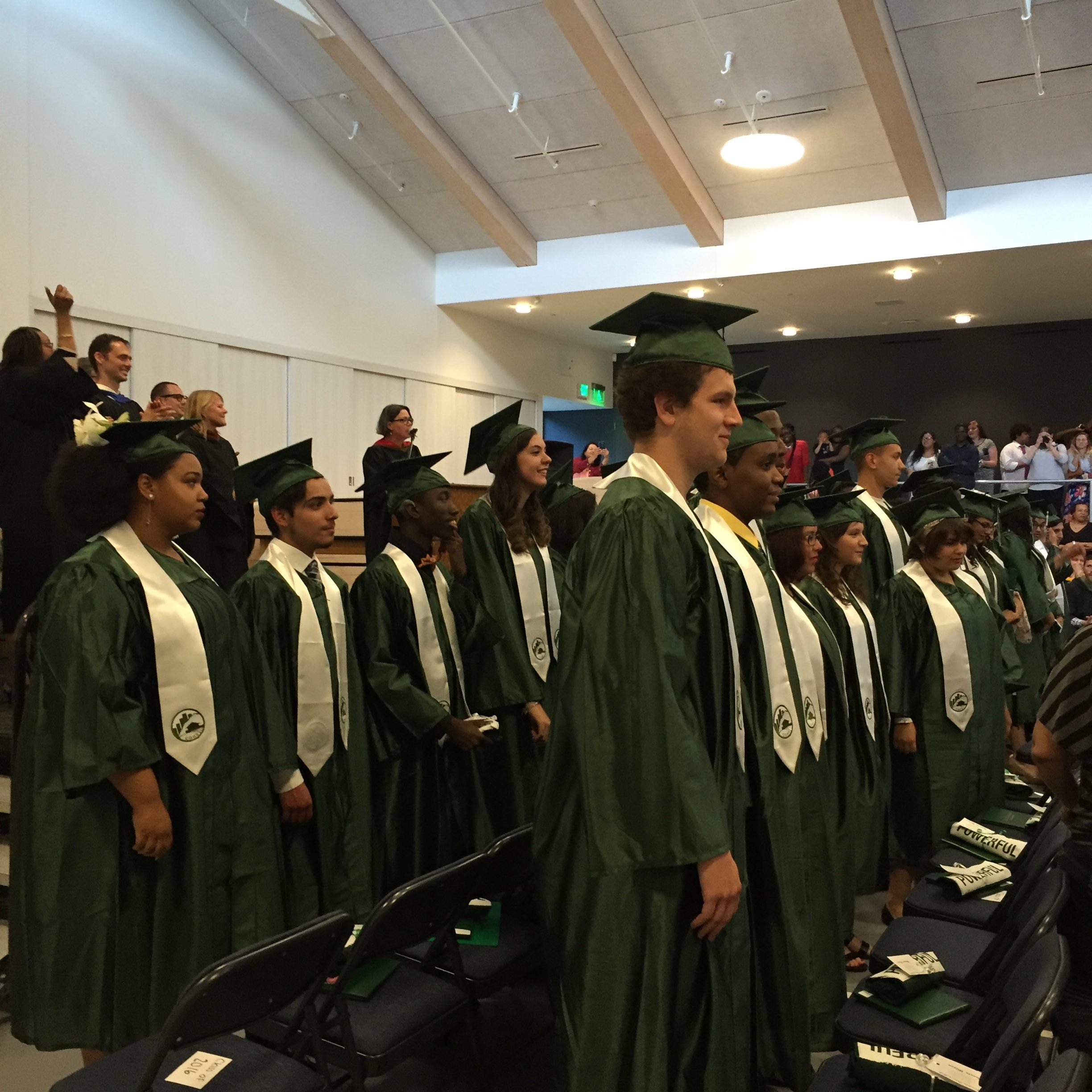 Students in caps and gowns at Common Ground's 2016 graduation.